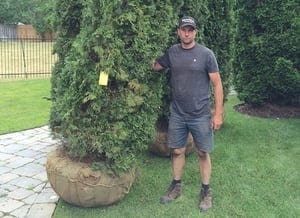 Image of Mike Holding a tree before planting